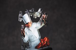 Funny custom award with chef tossing cooking tools