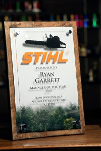 Stihl Manager of the Year Custom Award with wood background