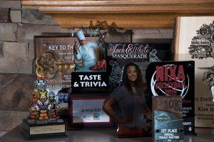 Many custom awards on display on a table